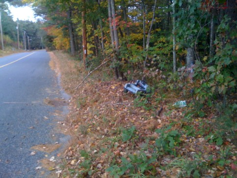 toy pedal car dumped on the side of East Brimfield Road